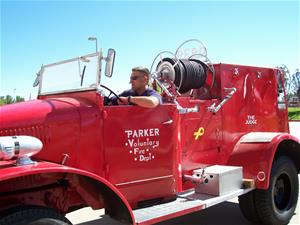 Man Driving in a Vintage Fire Truck