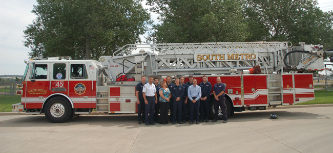 Firefighters Standing in Front of a Fire Truck
